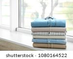 stack of clean clothes on... | Shutterstock . vector #1080164522