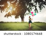happy young woman with colorful ... | Shutterstock . vector #1080174668