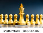 gold king chess piece stand in... | Shutterstock . vector #1080184502