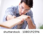 young man in woodworking hobby... | Shutterstock . vector #1080192596