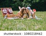 two beautiful girls eating... | Shutterstock . vector #1080218462