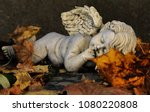 Weathered Angel Sculpture On A...
