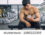 fitness man relaxing seat... | Shutterstock . vector #1080222305