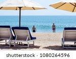unhappy couple on the beach.... | Shutterstock . vector #1080264596