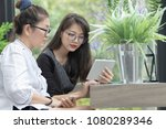 two asian working woman looking ... | Shutterstock . vector #1080289346