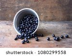 little  wild blueberry in cup | Shutterstock . vector #1080299558