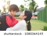 mom hug and carry her son.... | Shutterstock . vector #1080364145
