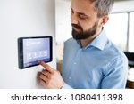 a man pointing to a tablet with ... | Shutterstock . vector #1080411398