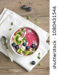 smoothie bowl with fresh... | Shutterstock . vector #1080431546