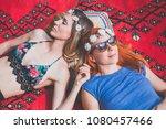 two hippie girlfriends enjoying ... | Shutterstock . vector #1080457466