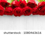 red roses on white wooden...   Shutterstock . vector #1080463616