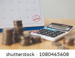 Stock photo tax payment season and finance debt collection deadline concept money coins stack calendar and 1080465608