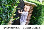 kid holding a lock and forge... | Shutterstock . vector #1080506816