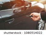 car key in business man hand. ... | Shutterstock . vector #1080514022