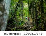two hikers make their way... | Shutterstock . vector #1080517148