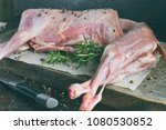 whole raw lamb and knife on the ... | Shutterstock . vector #1080530852