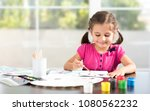 little girl is painting picture   Shutterstock . vector #1080562232