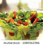 salad lettuce strawberries with ... | Shutterstock . vector #1080562586