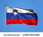 national flag of slovenia on a... | Shutterstock . vector #1080584588