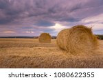 hay bales under a cloudy sunset ... | Shutterstock . vector #1080622355