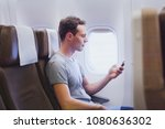 passenger of airplane using...   Shutterstock . vector #1080636302
