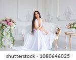 beautiful woman sitting in a... | Shutterstock . vector #1080646025