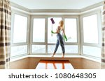 landlady washes the window and... | Shutterstock . vector #1080648305