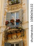 window and balcony with flowers ... | Shutterstock . vector #1080656132
