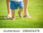 first baby steps.  closeup of...   Shutterstock . vector #1080656378