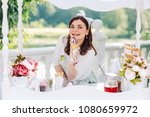 the saleswoman offers to buy... | Shutterstock . vector #1080659972