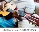 man playing on his guitar | Shutterstock . vector #1080723275