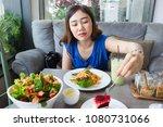 asian women enjoying eating a... | Shutterstock . vector #1080731066