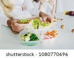 mother preparing sandwich for... | Shutterstock . vector #1080770696