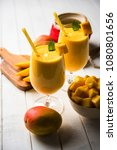 mango lassi or smoothie in big... | Shutterstock . vector #1080801656