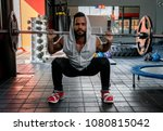 focused man lifting a barbell... | Shutterstock . vector #1080815042