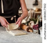 a woman making puff pastry... | Shutterstock . vector #1080817502