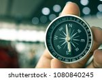 holding compass on blurry... | Shutterstock . vector #1080840245