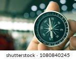holding compass on blurry... | Shutterstock . vector #1080840245