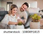 happy couple using laptop in...   Shutterstock . vector #1080891815