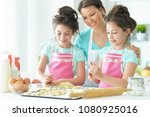 mom and daughters cook | Shutterstock . vector #1080925016