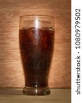 cola in glass on wood dark... | Shutterstock . vector #1080979502