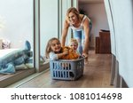 happy young mother pushing... | Shutterstock . vector #1081014698