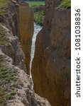 Small photo of Almost vertical scarp of an area in Pigheaded one of Pisuerga in the province of Valladolid (Spain)