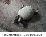 Small photo of Trouble, crisis concept, high angle view of businessman crushed by the huge stone on the street with copy space