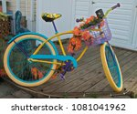 a colorful beach bike rests on... | Shutterstock . vector #1081041962