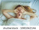 beautiful young woman lying...   Shutterstock . vector #1081062146