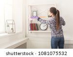 woman cleaning dust from... | Shutterstock . vector #1081075532