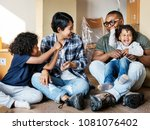 black family moving to new house | Shutterstock . vector #1081076402