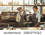 skilled barista teaching young... | Shutterstock . vector #1081079162