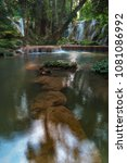 hidden waterfall in the deep...   Shutterstock . vector #1081086992